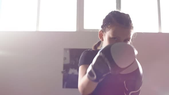Thumbnail for Portrait of a Teen Girl Boxer Working Out the Bumps in the Ring. Slow Motion