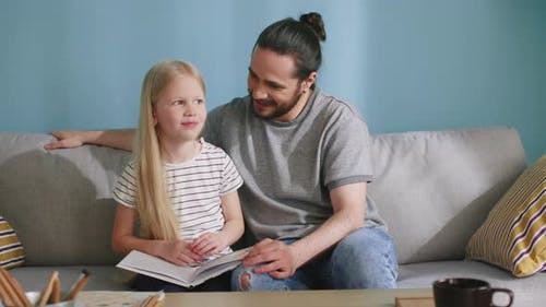 Small Girl Is Spending Time with Her Father