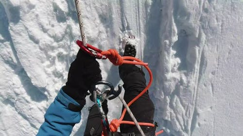 Alpinist Man Is Using Figure of Eight, Abseiling on Fixed Rope
