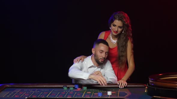 Thumbnail for Croupier Pushes a Young Couple To Win at Roulette Chips