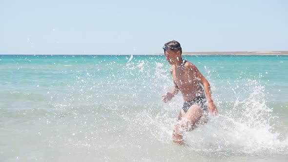 Happy Child Teen Runs on the Water of the Endless Azure Sea