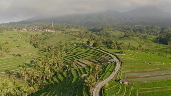 Mountain Range Silhouette with a Beautiful Aerial View of Rice Terraces