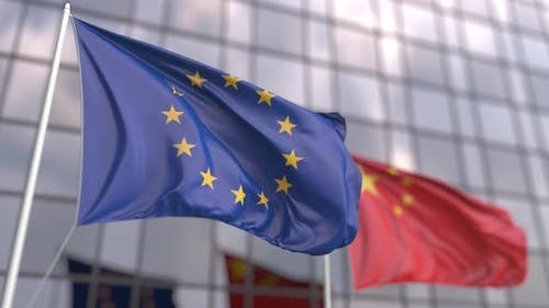 Flags of the European Union and China in Front of a Skyscraper