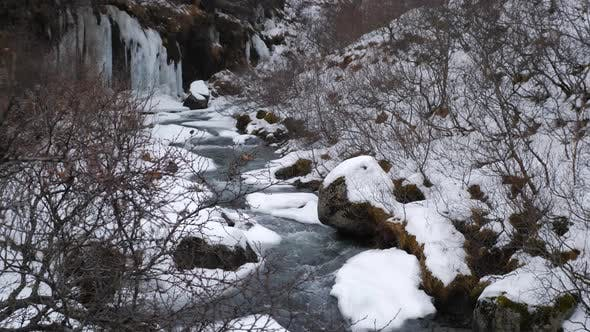 Thumbnail for Snow Covered Valley With Rushing Water In Iceland During Winter 3