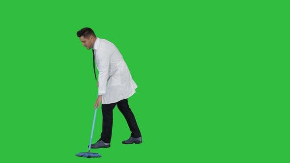 Thumbnail for Man in White Robe Sweeping the Floor and Talking on A Green