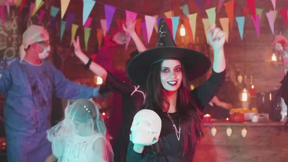 Thumbnail for Young Woman with a Beautiful Smile Dances Disguised As a Witch at a Halloween Party