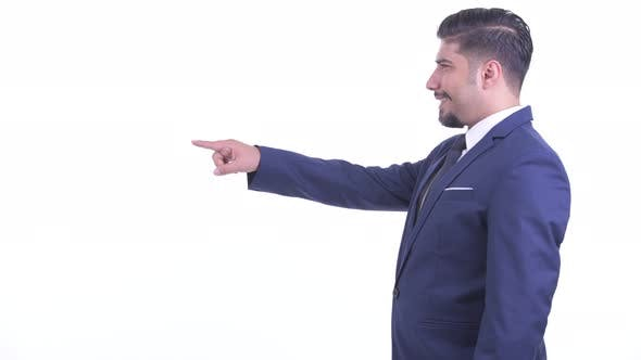 Thumbnail for Profile View of Happy Bearded Persian Businessman Pointing Finger