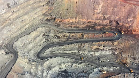 Huge Belaz Trucks Driving on the Pit Bottom in Mining Factory Mine Quarry in Ukraine