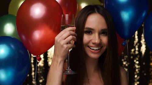 Happy Woman Celebrating Birthday Party With Champagne, Balloons