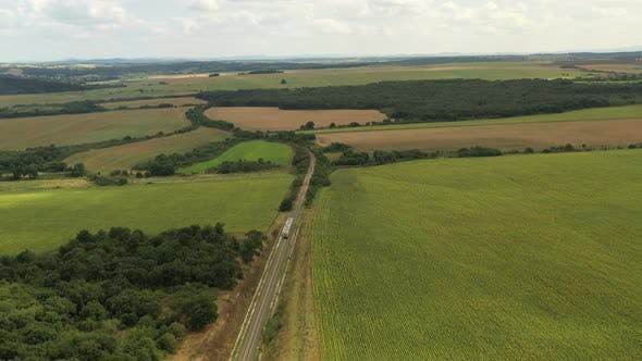 Passenger Train Passes Through Beautiful Farmland