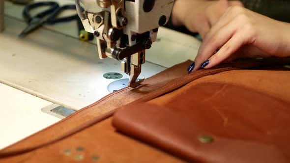 Thumbnail for Seamstress Sews Leather Bag in a Sewing Workshop. Woman Operates Sewing Machine