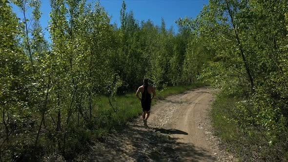 Sportsman Running on Path in Nature