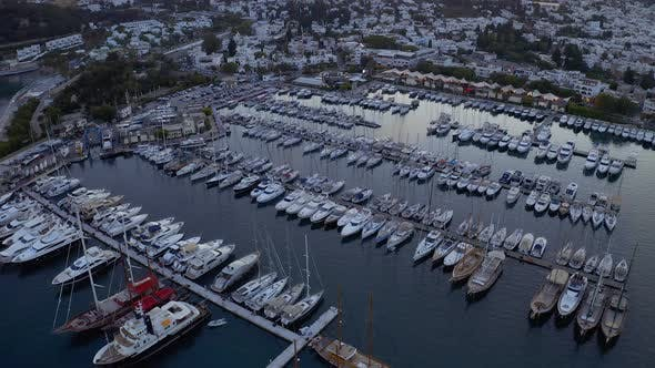 Thumbnail for Aerial Fly Over Boats and Yachts Moored in Port at the Sunset. View From Above