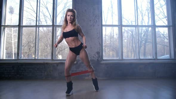 Thumbnail for Sporty Woman During Workout with Resistance Band