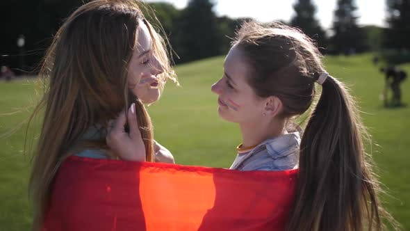 Thumbnail for Happy Lesbians Enjoying Closeness Wrapped in Flag