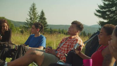 Portrait of Serene Diverse Multiracial Travelers Enjoying Recreation at Campsite in Morning