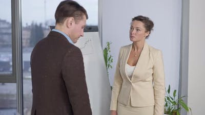 Angry Dissatisfied Woman Scolding Man in Office