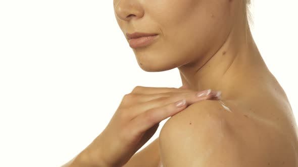 Thumbnail for The Blonde Smears Cream on Her Shoulders