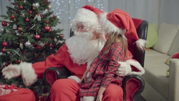 Thumbnail for Merry Christmas! Little Girl Plays And Receives Gifts From Santa Claus