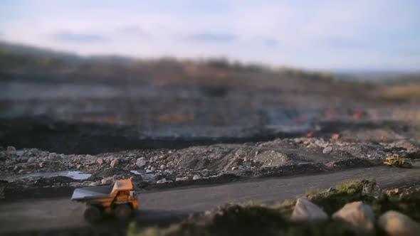 Wide-angle Tilt-shift Shot of an Empty Dump Truck Rides