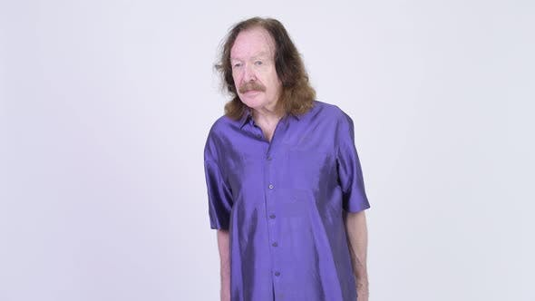 Thumbnail for Senior Man with Mustache Wearing Purple Silky Shirt