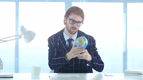 Thumbnail for Businessman Holding and Reading World Globe, Countries