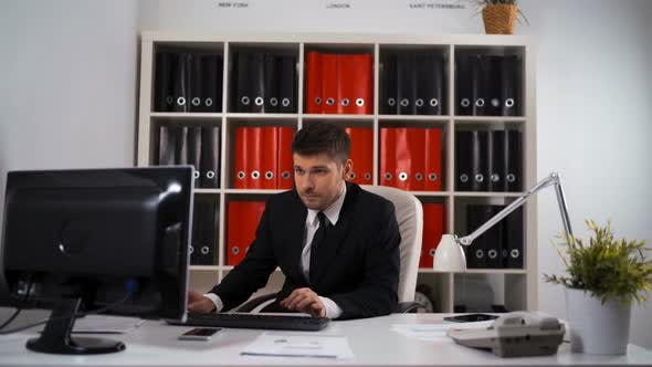 Thumbnail for Businessman Working with Computer in Office