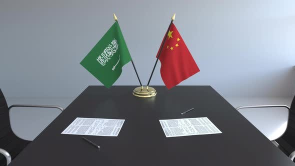 Thumbnail for Flags of Saudi Arabia and China and Papers on the Table