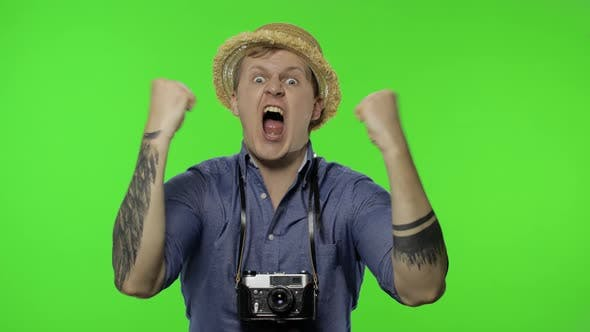 Thumbnail for Portrait of Young Man Tourist Photographer Looking Displeased, Angry, Chroma Key