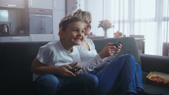 Thumbnail for Joyful Family Spending Time Playing Video Game