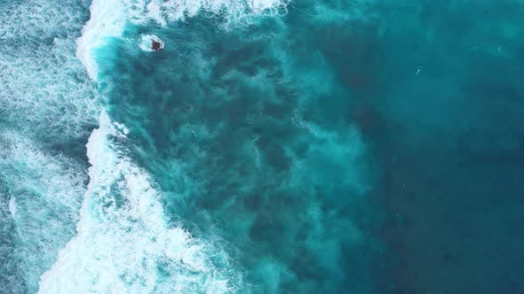 Waves and Azure Water as A Background. View from Drone at The Ocean Surface.