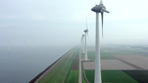 Thumbnail for Aerial View of a Giant Wind Farm Used for Renewable Energy on a Foggy Day