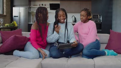 Positive African Adolescent Girl Video Conferencing with Tablet Pc