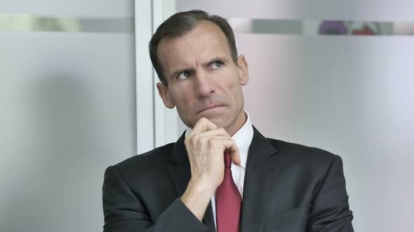 Thumbnail for Thinking Middle Aged Businessman in Office