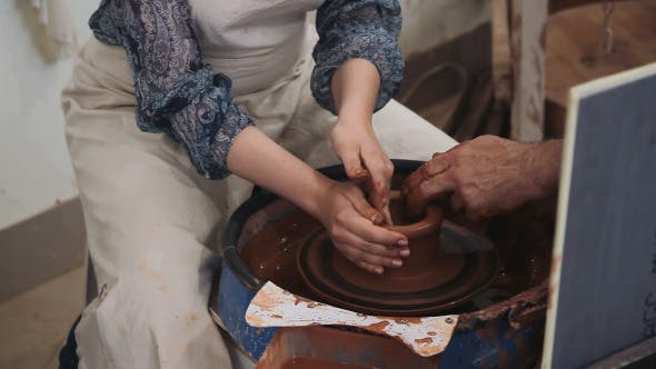 Thumbnail for Potter Working With Clay On The Machine