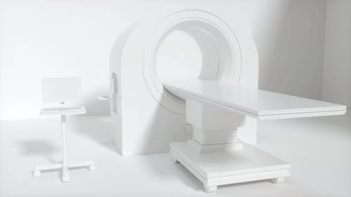 CT machine with white background, medical facility.