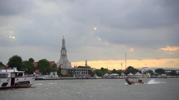 Thumbnail for Cruise ship sailing across river at golden sunset