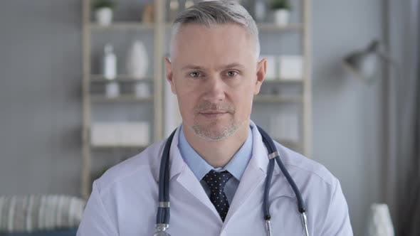 Thumbnail for Portrait of Serious Doctor with Grey Hairs