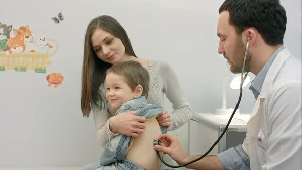 Thumbnail for Doctor Is Examining Boy with a Stethoscope