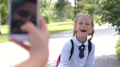 Mother Taking Photos of Daughter Before School