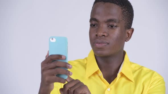Thumbnail for Face of Young Happy African Businessman Using Phone
