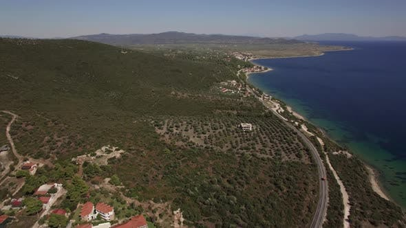 Thumbnail for Seashore with Cottages and Green Hills. Aerial View of Trikorfo Beach, Greece