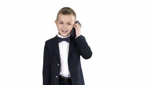 Thumbnail for Little Boy in A Costume Making a Phone Call While Walking