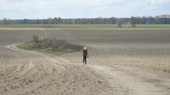 Thumbnail for Boy Walks Along the Path Through the Field