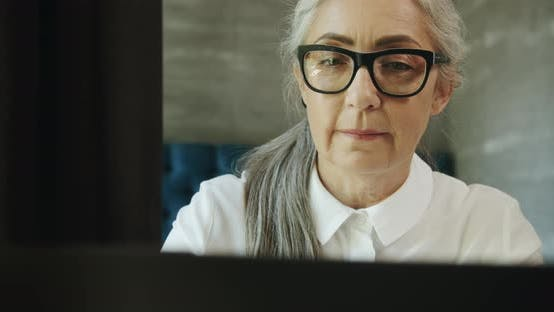 Thumbnail for Elderly Woman with Laptop
