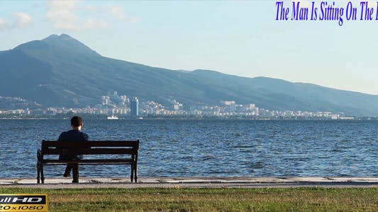 The Man Is Sitting On The Beach