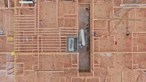 Aerial View of Masonry Brick Builders are Building Walls in Elevator Shaft on Under Construction