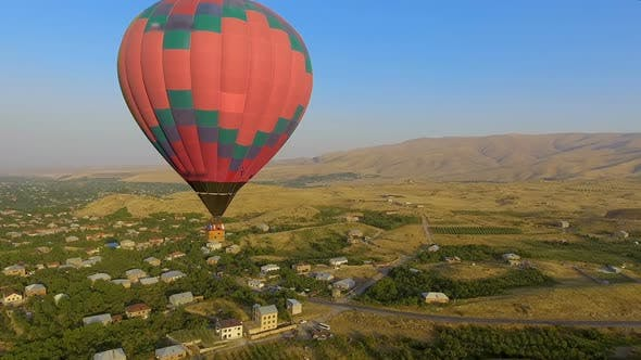 Thumbnail for Huge Multicolored Hot Air Balloon Flying Over Armenian Village, Landscape