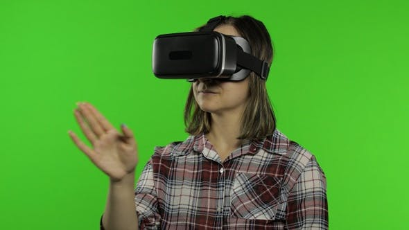 Thumbnail for Girl Using VR App Helmet To Play Simulation Game. Slide Gestures. Watching Virtual Reality 3d Video