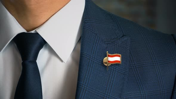 Thumbnail for Businessman Walking Towards Camera With Country Flag Pin Austria